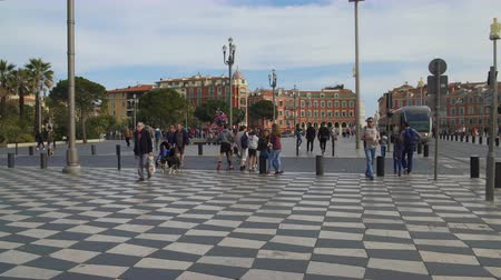 rendkívüli : Carefree tourists and locals strolling along mosaic pavement of Massena square Stock mozgókép