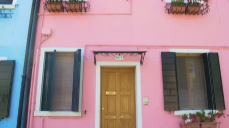 burano : Amazing view on doll-like pink house with flowerpots, sunny day, Venice