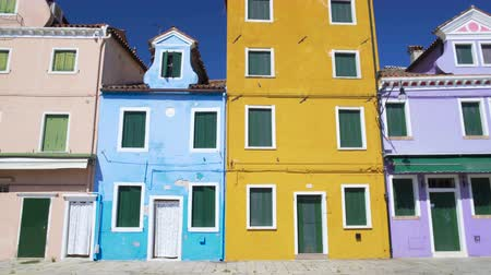 burano : View on old colorful residential houses in Burano, sunny day in Venice Stock Footage