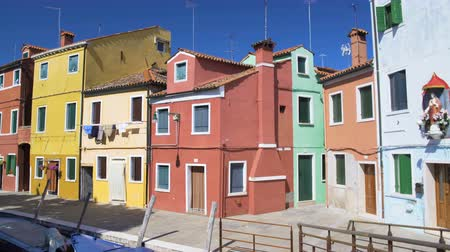 burano : View on yellow, pink and blue houses on Burano island, architecture in Venice