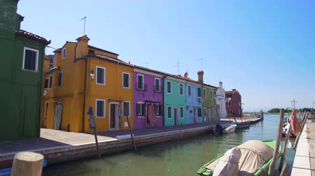 burano : Beautiful multicolored houses and canal in Venice, colorful buildings in Burano Stock Footage