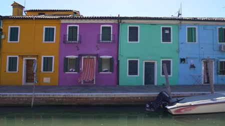 motorbot : View on yellow, purple, blue and green houses in Burano, architecture in Venice