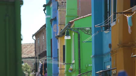 arrumado : Beautiful colorful houses with curtains on doors, famous area in Burano, Venice