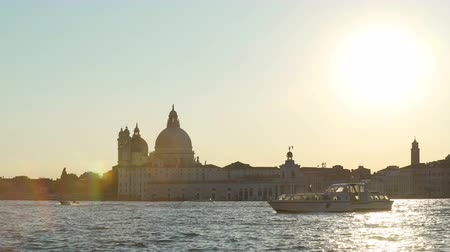 mary : Touristic boat floating on Grand Canal near Santa Maria della Salute basilica
