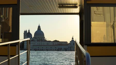 mary : View on Santa Maria della Salute cathedral from ship floating on Grand Canal Stock Footage