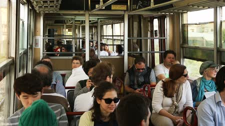 dojíždění : People sitting in car of city train moving rapidly along open air rail at day Dostupné videozáznamy