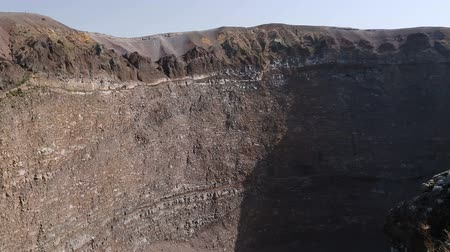 hardened lava : Vesuvius with rocky slopes and cauldron-like crater shown from above, sequence