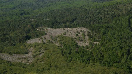 inspirar : Slope with poor vegetation and panorama of hillsides covered by forest, sequence Vídeos