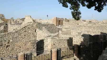 neapol : Remains of excavated residential buildings in Pompeii city on sunny day sequence