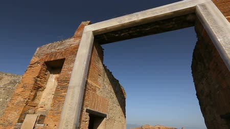 millennium : Big square entrance in ruined wall in Pompeii, Latin inscription on entablature