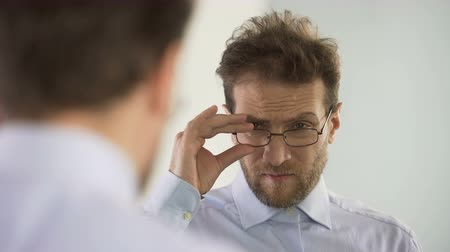 gentleman : Man dissatisfied with his glasses and thinking about vision correction procedure