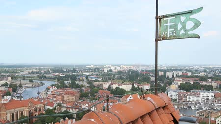 lapát : Old iron vane standing on the building roof, view on amazing Gdansk city, Poland
