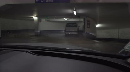 множество : Driver of luxury car leaving hotel underground parking, going on business