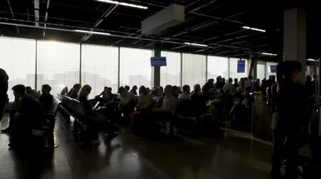 отменить : Passengers sitting at departure lounge and waiting for boarding, terminal