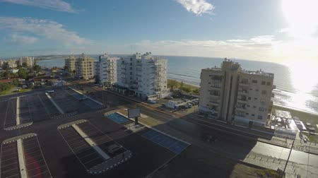 kypr : View on car parking and high buildings placed near beach in Larnaca city