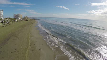 parasol : Sea waves washing ashore in Larnaca city, beautiful aerial view on beach Stock Footage