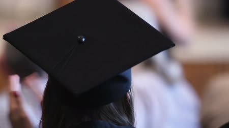 commencement : Joyful woman wearing graduation cap and applauding to teachers farewell Stock Footage