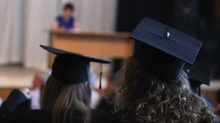 grãos : Excited graduates listening and watching professors speech, happy holiday Stock Footage