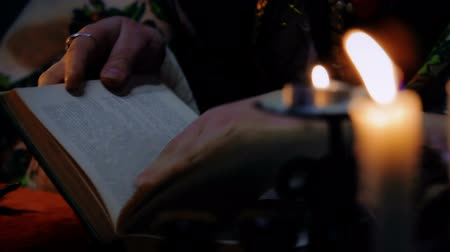 shaman : Enchantress opening the book and reading a spell, white magic, extrasensory