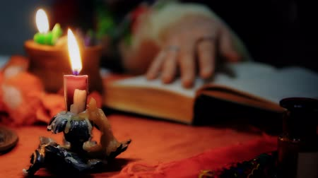 shaman : Female psychic invoking the spirits with burning candles, magic and wizards