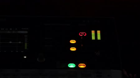 klub : View on lighting buttons and equalizer on audio console, sound equipment Wideo
