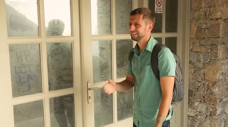 private museum : Male tourist disappointed to see closed and abandoned museum, emotions in face Stock Footage