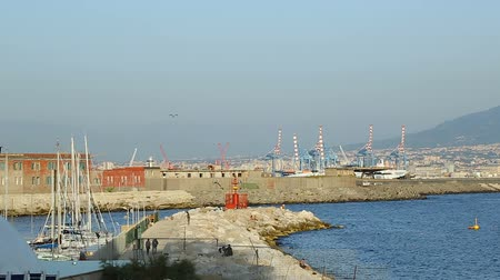 moorage : Beautiful view of Port of Naples with industrial cranes, yachts and buildings