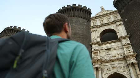 neapol : Man looking at amazing facade of triumphal arch of New Castle, sightseeing tour