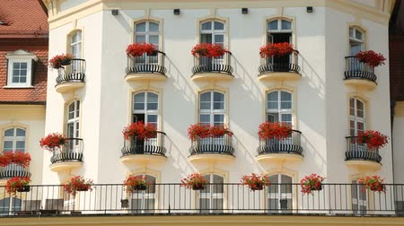 элита : Flowered balconies of elite mansion or luxury hotel, expensive real estate
