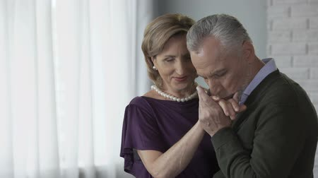 gentleness : Retired man and woman dancing, man kissing woman hand, dating club for elderly Stock Footage