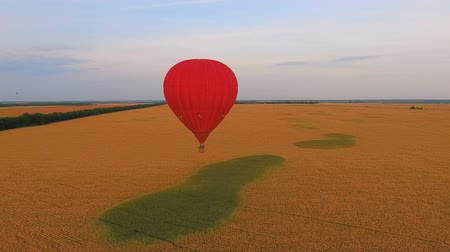 koperta : Air balloons flying over rural fields, contestants of ballooning championship