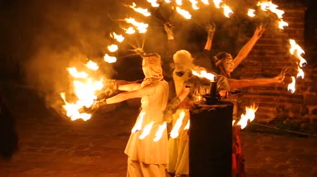 театральный : Local circus carrying open air fire performance for tourists and city residents