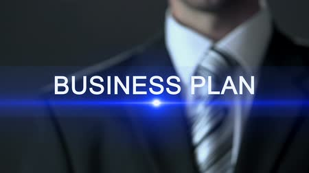 fejleszt : Business plan, male in business suit touching screen business development action Stock mozgókép