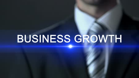 расширение : Business growth, man in formal suit touching screen, business concept, expansion Стоковые видеозаписи