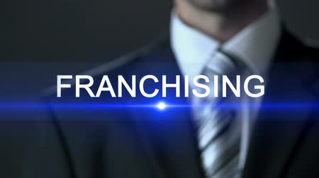 franczyza : Franchising, businessman in official suit touching screen, commercial branch