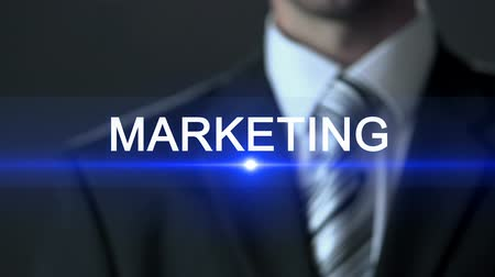 oficiální : Marketing, male wearing official suit touching screen, product promotion, advert