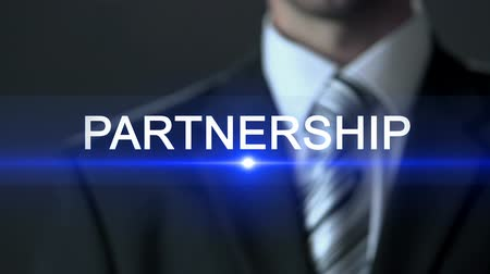 companionship : Partnership, businessman wearing suit touching screen, company collaboration Stock Footage