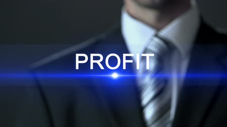 rentável : Profit, male in business suit touching screen, financial success business growth