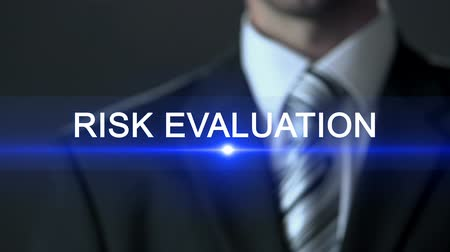 probabilidade : Risk evaluation, man wearing business suit touching screen, analytical research Stock Footage