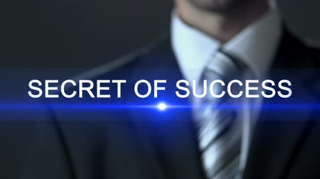 aspire : Secret of success, man wearing business suit pressing buttons on screen, story