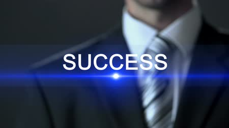 outstanding : Success, man wearing business suit touching screen, fortune, prominent career Stock Footage