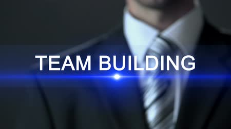 premente : Team building, businessman in suit touching screen, human resource, bonding
