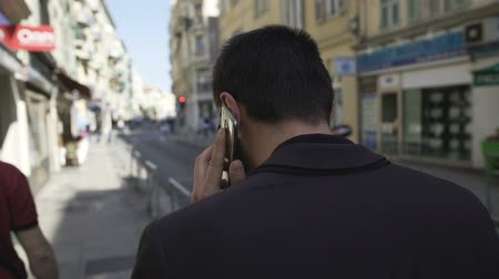 wandering : Frustrated businessman discussing problems on phone and walking city street Stock Footage