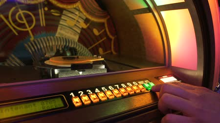 collectible : Male hand pushing buttons to play song on old musical box, selecting records Stock Footage