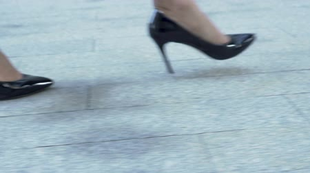high heeled shoe : Woman in expensive high heel shoes gracefully rising up stairs, businesswoman