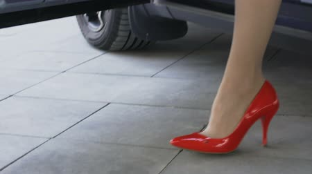 дорогой : Business lady getting out of car and confidently walking away, feet closeup