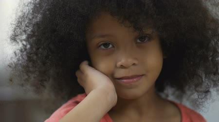 afro americana : Beautiful Afro-American kid smiling at camera, positive emotions, closeup Stock Footage