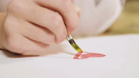 püskül : Hands of romantic girl mixing colors, painting beautiful red heart, love dreams Stok Video