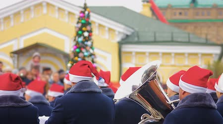 jazz festival : Brass band playing Christmas carols creating holiday spirit, street performance
