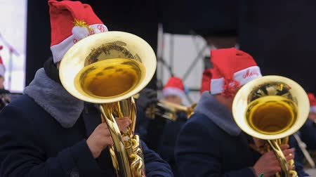 headwear : Brass orchestra in funny hats playing Christmas carols creating holiday spirit